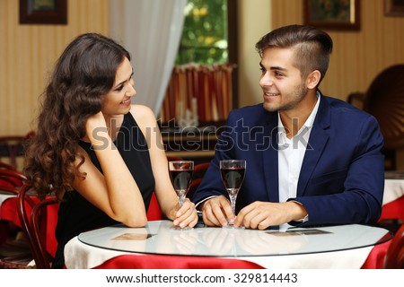 attractive young couple dating at the restaurant - stock photo