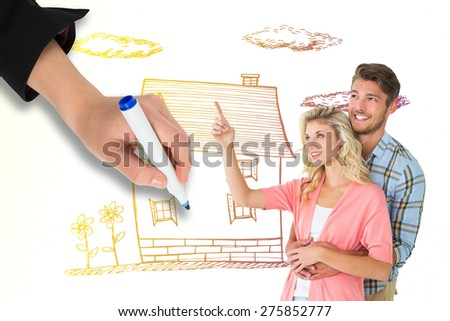Attractive young couple embracing and looking against grey - stock photo