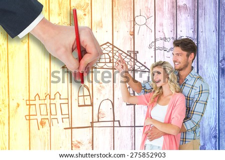 Attractive young couple embracing and pointing against digitally generated grey wooden planks - stock photo