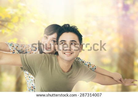 Attractive young couple enjoying togetherness in summer holiday at the park - stock photo