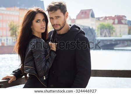 Attractive young couple in autumn jacket hugging each other - stock photo