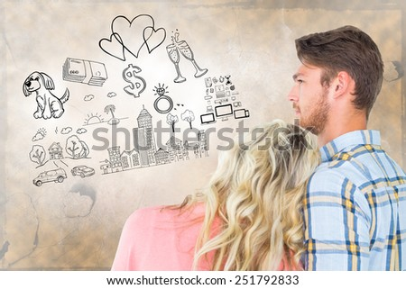 Attractive young couple looking together against life thoughts - stock photo