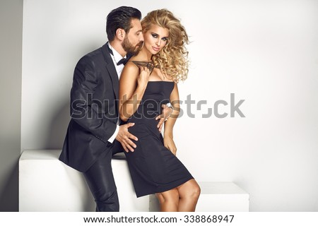 Attractive young couple posing close together - stock photo