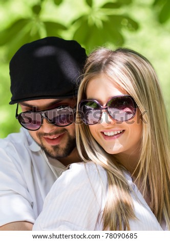 Attractive young couple posing outdoor at sunset in nature - stock photo