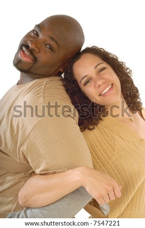 Attractive young couple's portrait with locked arms to show closeness - stock photo