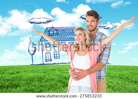 Attractive young couple smiling and embracing against blue sky over green field - stock photo