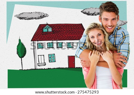 Attractive young couple smiling at camera against grey - stock photo