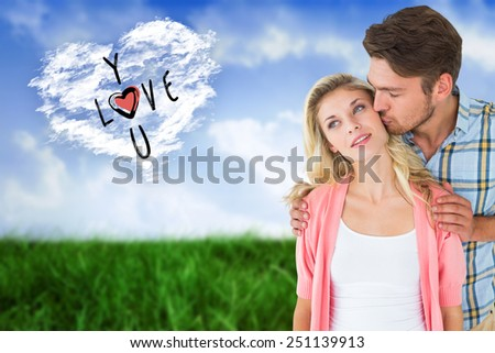 Attractive young couple smiling together against cloud heart - stock photo