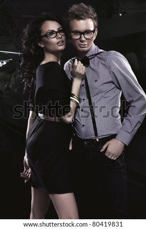 Attractive young couple wearing glasses - stock photo