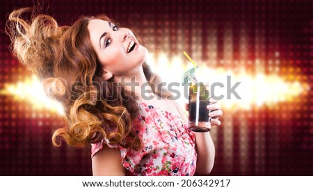 attractive young dancing woman - stock photo