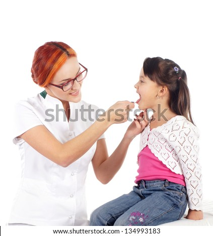 Attractive young doctor and the little girl isolated on white - stock photo