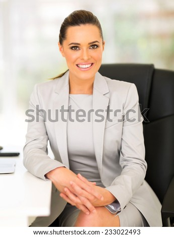 attractive young entrepreneur sitting in office - stock photo