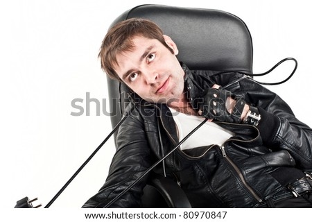 attractive young Europeans in the Caucasus,a black leather jacket,strangled by electric cables leather chair, looks emotionally cord around his neck,a wire around his neck, fork,isolated over white - stock photo