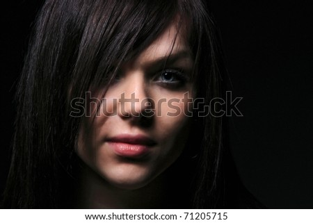 Attractive young fashion model over gray background - stock photo