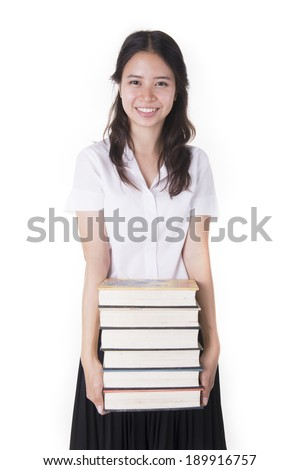 Attractive young female college student carrying a stack of book - stock photo