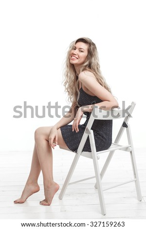 attractive young female in dress isolated on white - stock photo