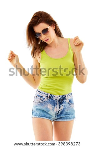 Attractive young female in jeans shorts and green top, isolated over white background - stock photo