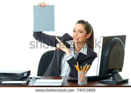attractive young female office worker holds empty grey card in front of her, isolated on white background - stock photo