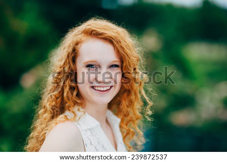 Attractive Young Female Redhead, laughing - stock photo