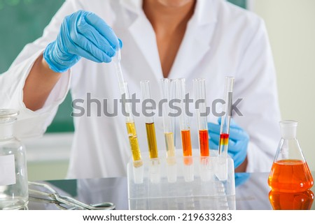 Attractive young female scientist working in laboratory, chemistry, biology, biochemistry - stock photo