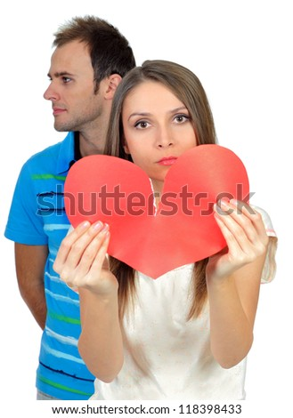 Attractive young girl holding broken paper red valentine heart - stock photo