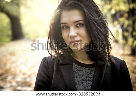 Attractive young girl in a Moscow park in autumn - stock photo