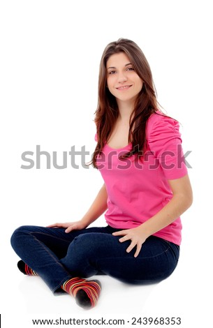 Attractive young girl in pink sitting on the floor isolated on a white background - stock photo