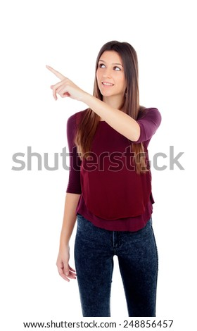 Attractive young girl indicating something isolated on a white background - stock photo