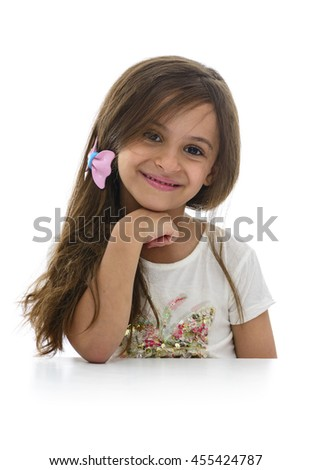 Attractive Young Girl Sitting With Beautiful Smile Isolated on White Background - stock photo