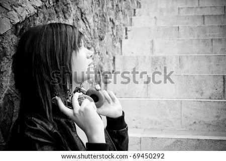 Attractive young girl taking off the headset - stock photo