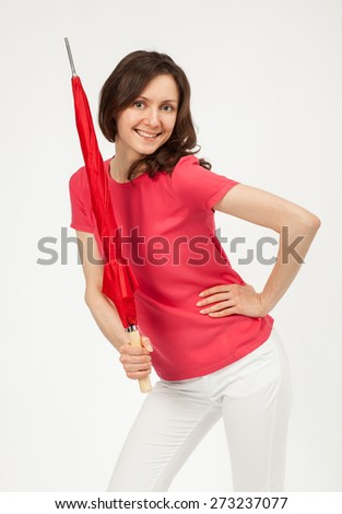 Attractive young girl with red umbrella posing in studio, white background - stock photo