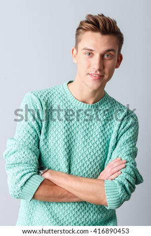 Attractive young guy is posing with confidence - stock photo