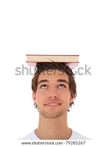 Attractive young man balancing a book on his head. Extra copy space on top. All on white background. - stock photo
