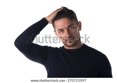 Attractive young man headshot looking at camera, touching his hair, isolated on white - stock photo