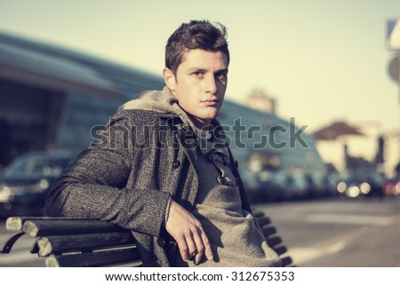 Attractive young man in urban environment - stock photo
