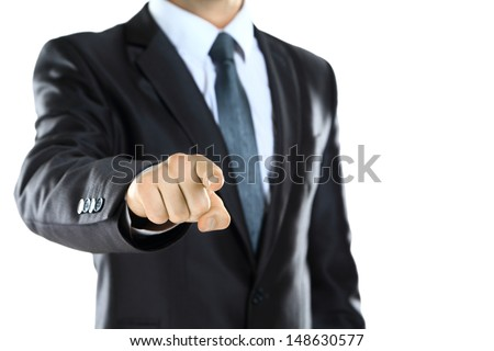 attractive young man pointing a finger towards you - stock photo