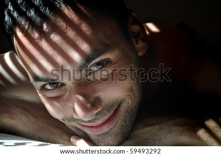 Attractive young man portrait in special lightening - stock photo