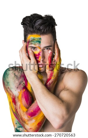 Attractive young man shirtless, skin painted all over with bright Holi colors isolated on white background - stock photo