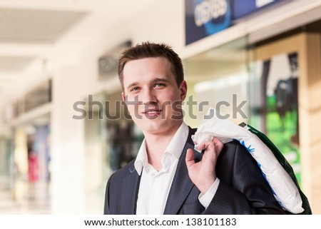 Attractive young man shopping with bags at the store - stock photo