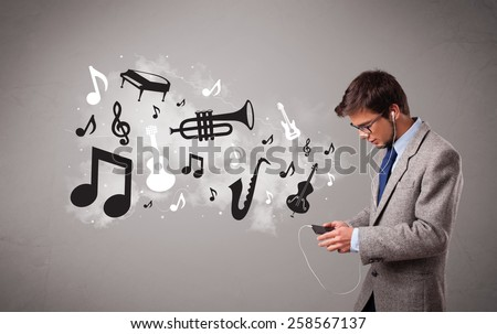 attractive young man singing and listening to music with musical notes and instruments getting out of his mouth - stock photo