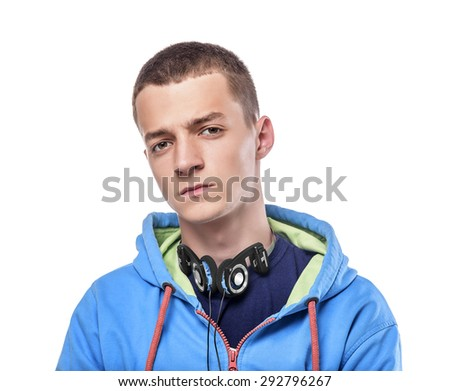 Attractive young man wearing headphones isolated on white.  - stock photo