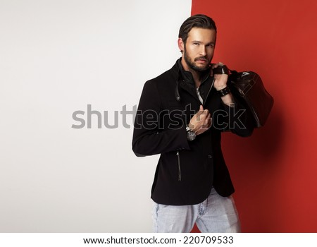 Attractive young man with case - stock photo