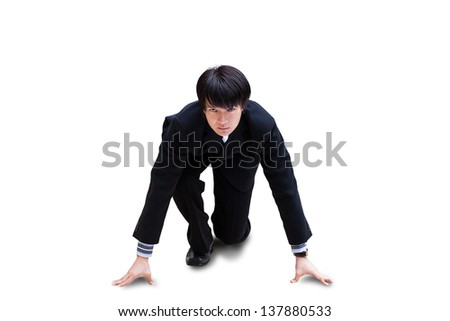 Attractive young nepalese businessman with suitcase kneeling, ready for race, Isolated over white background with clipping path - stock photo