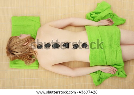 Attractive young nude woman getting ready for spa treatment. - stock photo