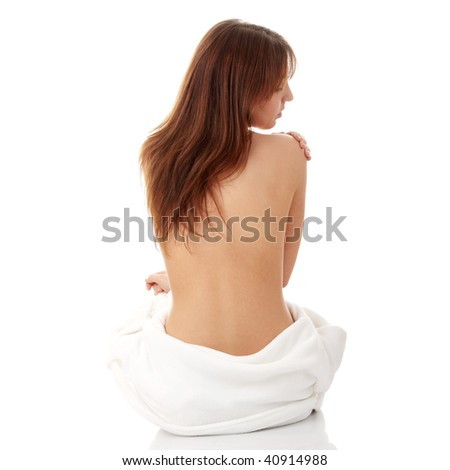 Attractive young nude woman getting ready for spa treatment, isolated on white - stock photo