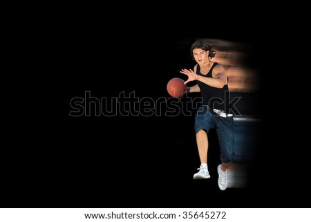attractive young person with basketball ball a over black background. - stock photo
