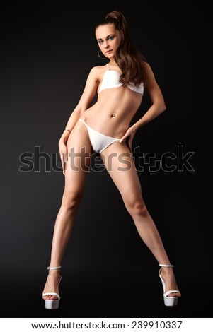Attractive Young Pin Up Model Posing in White Sexy Lingerie  - stock photo