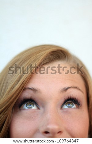 Attractive, Young Professional Business Woman Smiling and Looking Up - stock photo