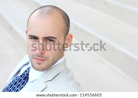 Attractive, Young Professional Serious and Mature Businessman Man Looking at the Camera - stock photo