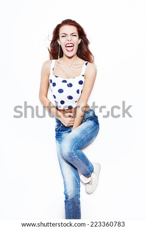 Attractive young red-haired women screaming, singing, listening to music - stock photo